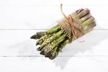 Bunch of green asparagus on white wood, elevated view - MAEF008342
