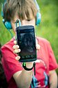 Little boy showing smartphone with selfie - SARF000661
