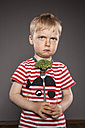Portrait of angry looking little boy holding fork with broccoli - OJF000038