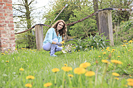 Young woman working in the garden - VTF000262