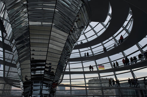 Germany, Berlin, people looking at view from glass dome of Reichstag - AS005388