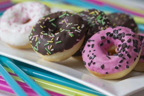 Plate of decorated doughnuts, close-up - YFF000149