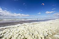Netherlands, Zeeland, Walcheren, Domburg, Beach, Kite surfer, Foam on the waterfront - THA000439