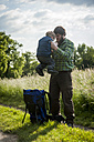 Germany, Rhineland-Palatinate, Moselsteig, father and his little son having a break from hiking - PA000707