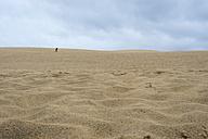 France, Aquitaine, Gironde, Pyla sur Mer, Dune du Pilat, running boy on a desertlike sand dune - JBF000139
