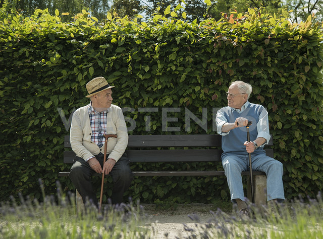 Germany, Worms, Two old friends sitting on bench in park - UUF000695