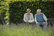 Two old men using tablet computer in the park - UUF000697