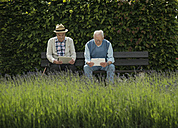 Two old men using tablet computers in the park - UUF000699