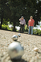 Two old friends playing boule in the park - UUF000717