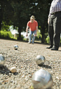 Two old friends playing boule in the park - UUF000718