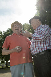 Two old friends with boule balls in the park - UUF000720