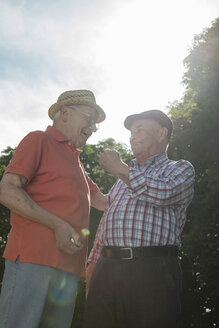 Two old friends with boule balls in the park - UUF000721