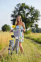Young woman on bicycle tour in summer - GO000003