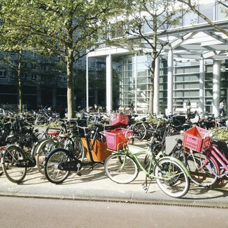 The Netherlands, Amsterdam, Bicycles in front of a modern office building, - HAWF000227