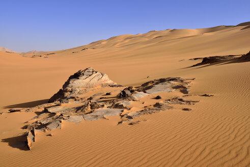 Africa, Algeria, Sahara, Tassili N'Ajjer National Park, Tadrart, Rocks and sand dunes at Oued In Djerane - ES001180
