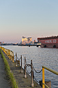 Germany, Hamburg, container ship on River Elbe with Elbphilharmonie in background - MS003990
