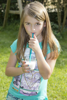 Portrait of girl drinking milk with drinking straw - YFF000159