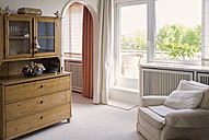 Living room with armchair and old cupboard - TKF000353