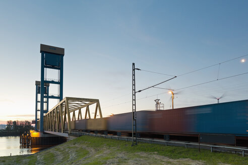 Germany, Hamburg, Kattwyk bridge, Train with containers, Wind wheels in the background - MSF003996
