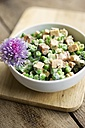 Creamy pea salad with spicy tofu pieces, soy yogurt, chives and mint - HAWF000246