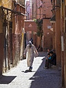 Morocco, Marakesh, Medina, muslima walking in alley Derb Dabachi - AM002309