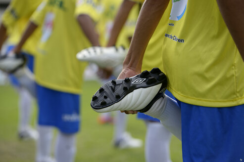 Brazil, Rio de Janeiro, football team of Street Child World Cup 2014 making stretching exercises, partial view - FLK000313