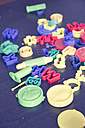 Many toy cutters lying on wooden table - LVF001414