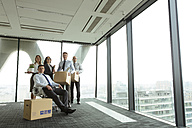 Businesspeople moving into new office - WESTF019484