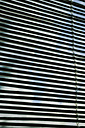 Cloudy sky reflecting on blinds - MEM000176