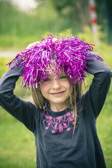 Portrait of smiling little girl with decoration material on her head - SARF000689