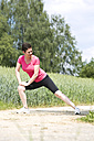 Woman making stretching exercises outside - MAEF008382