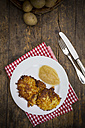 Potato fritters with apple sauce on plate - LVF001401