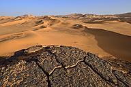 Africa, Algeria, Sahara, Tassili N'Ajjer National Park, Tadrart, Rocks and sand dunes at Oued in Djerane - ES001199