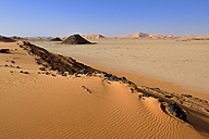 Africa, Algeria, Sahara, Tassili N'Ajjer National Park, Tadrart, Claypan and sand dunes at Oued in Djerane - ES001202
