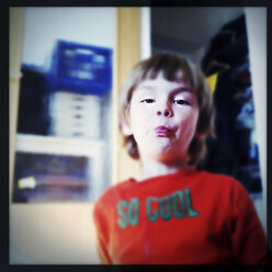 Three year old boy with his mouth full - ZMF000301