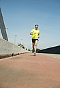 Man jogging on bridge - UUF000933