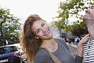 France, Paris, portrait of happy young woman having fun with her boyfriend - FMKF001266