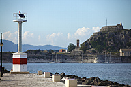 Greece, Ionic Islands, Corfu, harbour light at Garitsa bay - AJF000061