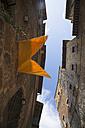 Italy, Tuscany, San Gimignano, Row of houses - MYF000371