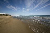 Italy, Tuscany, Castiglione della Pescaia, Beach and Island Elba in the background - MYF000416
