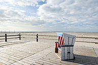 Germany,Schleswig-Holstein, North Sea, Sankt Peter-Ording, Canopied beach chair - RJF000184