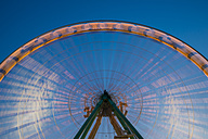 Germany, North Rhine-Westphalia, Cologne, part of lighted turning big wheel at blue hour - WGF000322