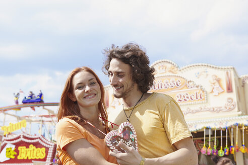 Happy young couple on a funfair - RHF000378
