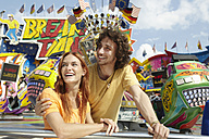 Happy young couple on a funfair - RHF000358