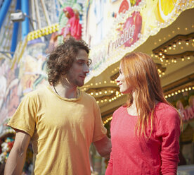 Young couple on a funfair - RHF000364