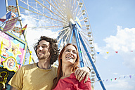 Happy young couple on a funfair - RHF000367