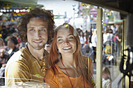 Happy young couple on a funfair - RHF000376