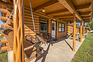 USA, Texas, Front of log homes - ABAF001352