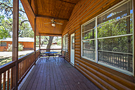 USA, Texas, Porch of log home cabin - ABAF001362