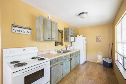 USA, Texas, Rustic Kitchen Interior of Guest Home - ABAF001369